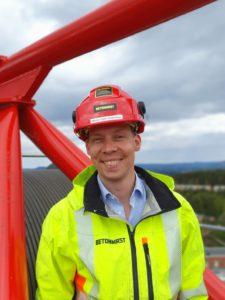 Foto av mann fra toppen av en byggekran