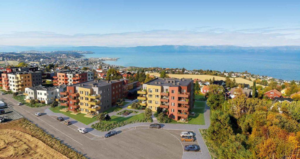 Illustrasjon av boligområde med åker og sjø i bakgrunnen