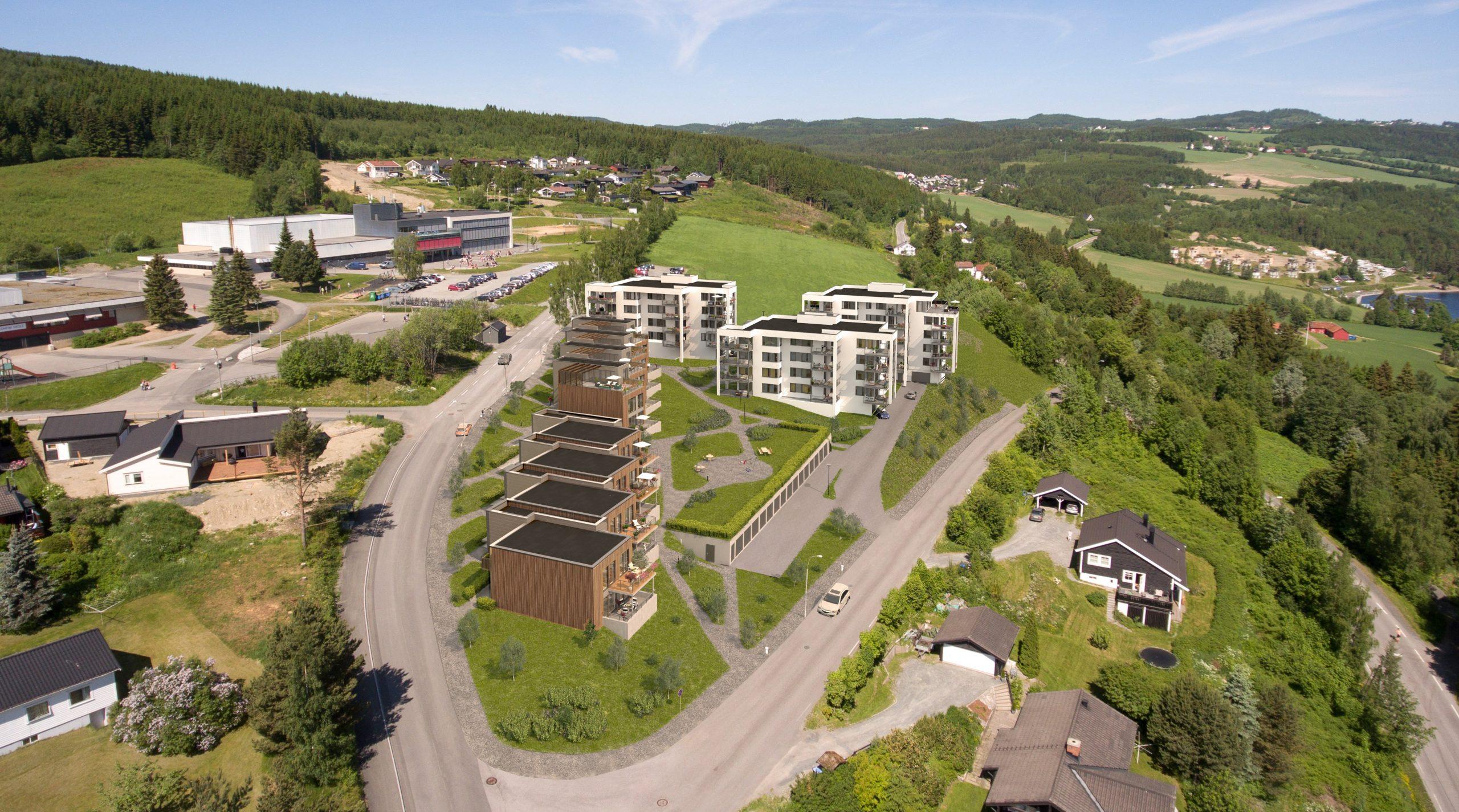Illustrasjon av rekkehus og blokker i en grønn skråning