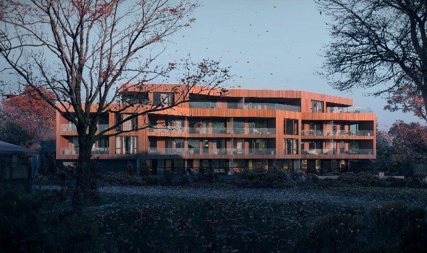 Illustrasjon av leilighetsbygg på fire etasjer, med gyllen fasade og høstlige omgivelser